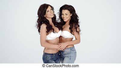 Sexy Women Wearing White Bras and Jeans - Two Sexy Young...