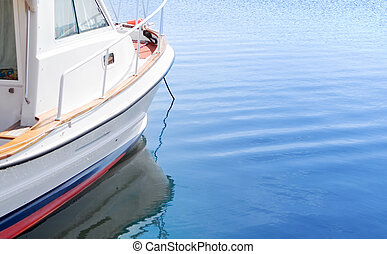 White boat on tranquil blue water