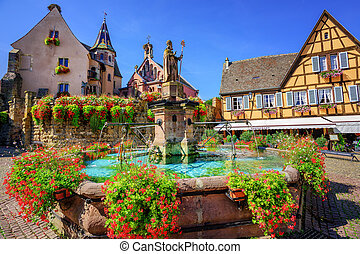 Eguisheim, France - Half-timbered medieval houses decorated...