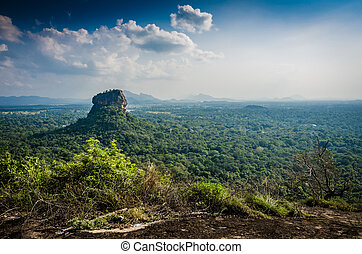 Sigiriya is an ancient palace located in the central Matale...