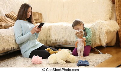 Mom with a child playing with dolls - Mom with a child...