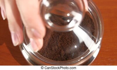 Open glass jar of instant coffee, slow motion - Opening...