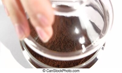 Open and close glass jar of instant coffee, slow motion, on...