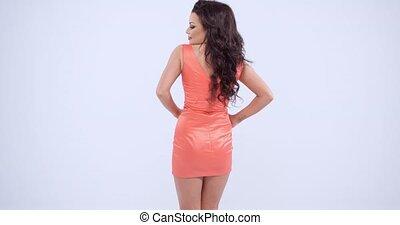 Gorgeous Woman in Orange Peach Dress - Three Quarter Shot of...