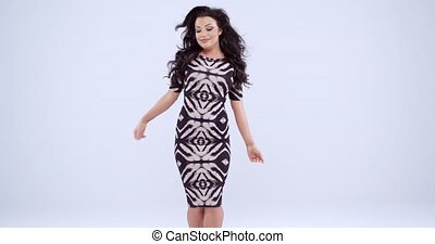 Sexy woman dancing in a trendy dress - Sexy woman dancing in...