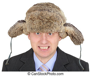 Angry Russian businessman in fur hat on white