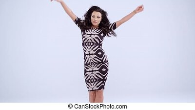 Woman in Printed Dress Against Gray Background - Three...