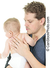 happy father holding baby boy in his hands isolated on white
