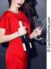 woman in red dress with champagne