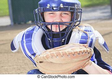baseball catcher at the sun light - A baseball catcher at...
