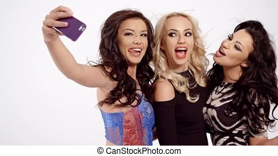 Three sexy women posing for a selfie - Three sexy young...