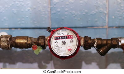 Water meter counter. - Counter hot water mounted on a water...