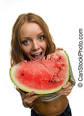 girl holding a piece of watermelon
