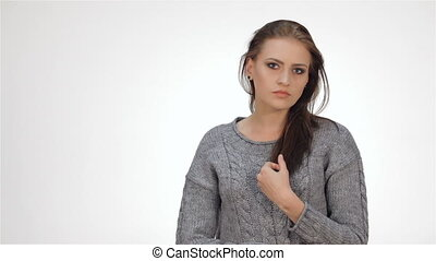 Beautiful teenage girl smiling and posing into the camera....