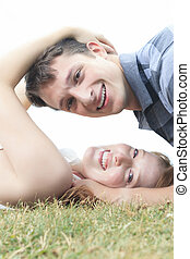 Couple lay grass - A couple lay on the grass close to each...