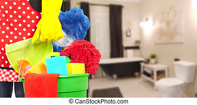 Maid hands with cleaning tools. House cleaning service...