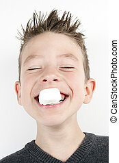 Portrait of cute joyful boy with a marshmallow - A Portrait...