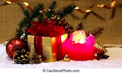 Red Advent candle and Christmas gift.