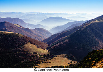 Scenic view of misty autumn hills and mountains, Slovakia -...