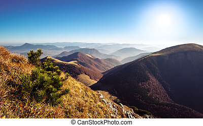 Scenic view of misty mountain hills in fall, Slovakia -...