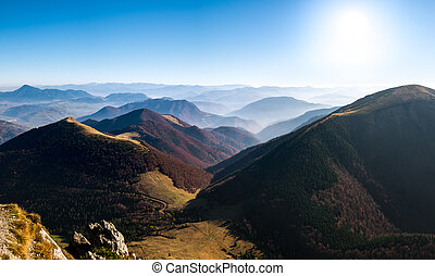Panoramic landscape view of beautiful autumn hills and...