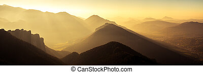 Panoramic scenic view of mountains and hills silhouette at...