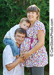 Happy family Pregnant mother with her husband and son in the...