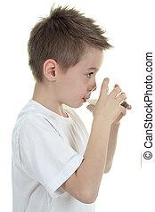 Child drinking milk on white background - Little boy and...
