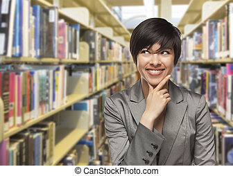 Mixed Race Girl Looking to the Side in the Library