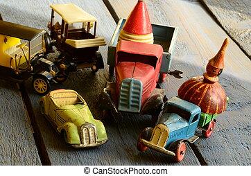 Set of vintage toys - convertible toy car, trucks (lorries)...