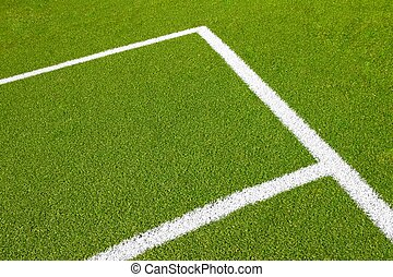 green empty football soccer field with corner under daily...