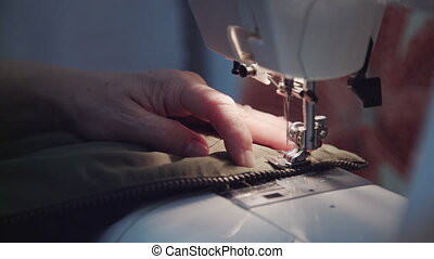 Woman sews on the sewing machine - Sewing Process - Womens...