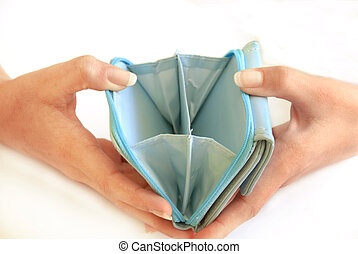 Empty wallet - female hands holding empty blue wallet over...
