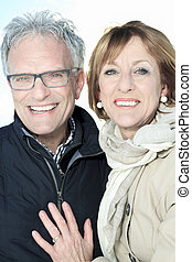 Portrait of happy senior couple in winter season - A...