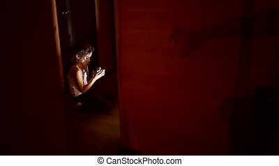 teen girl sitting in the hallway attacking monster shadow...