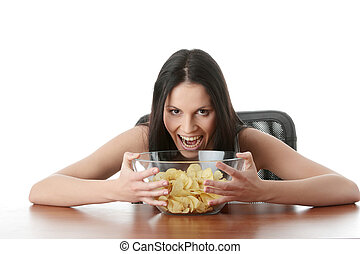 Chips - Young beautiful woman eating chips, isolated on...