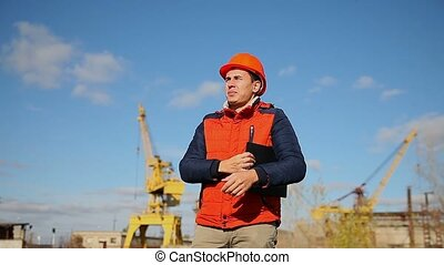 builder man in helmet corrects orange shouts calling shout...