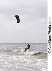 Kite surfer - Two men kite surfing on waves of ocean
