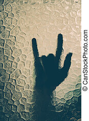 hand behind the glass