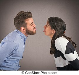 Funny couple - Man and woman playing are made grimaces