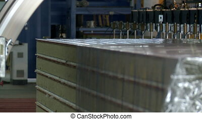 Close-up of machine packs sandwich panels - View of machine...