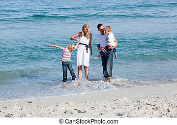 Lively family having fun at the beach - Lively family having...