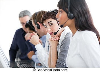 Charming businesswoman with headset on in a call center