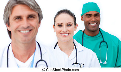 Self-assured medical team standing against a white...
