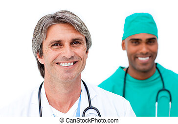 Smiling male doctors standing in a line against a white...
