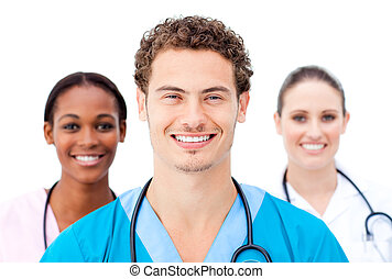 Smiling young doctors standing in a row