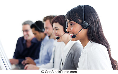 Self-assured business people using headset in a call center