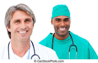 Charismatic male doctors standing in a line against a white...
