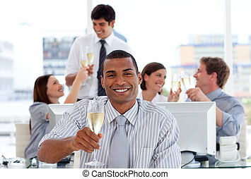 Ambitious business team drinking champagne