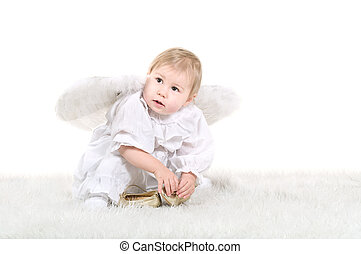 Little cute child an angel with wings on back are sitting on...